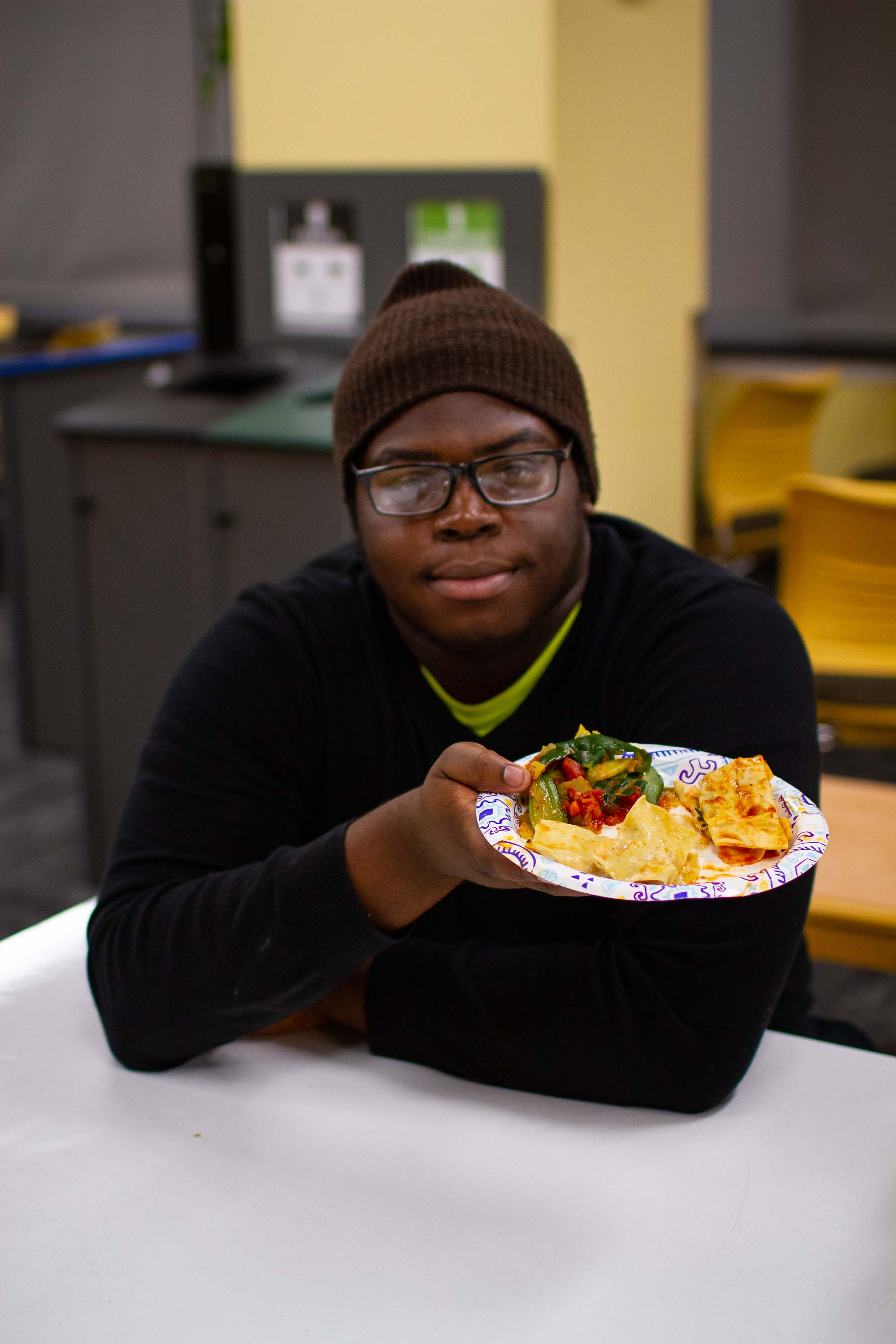 CHEW-MBC president Tola Abu '20 shows off a finished meal.