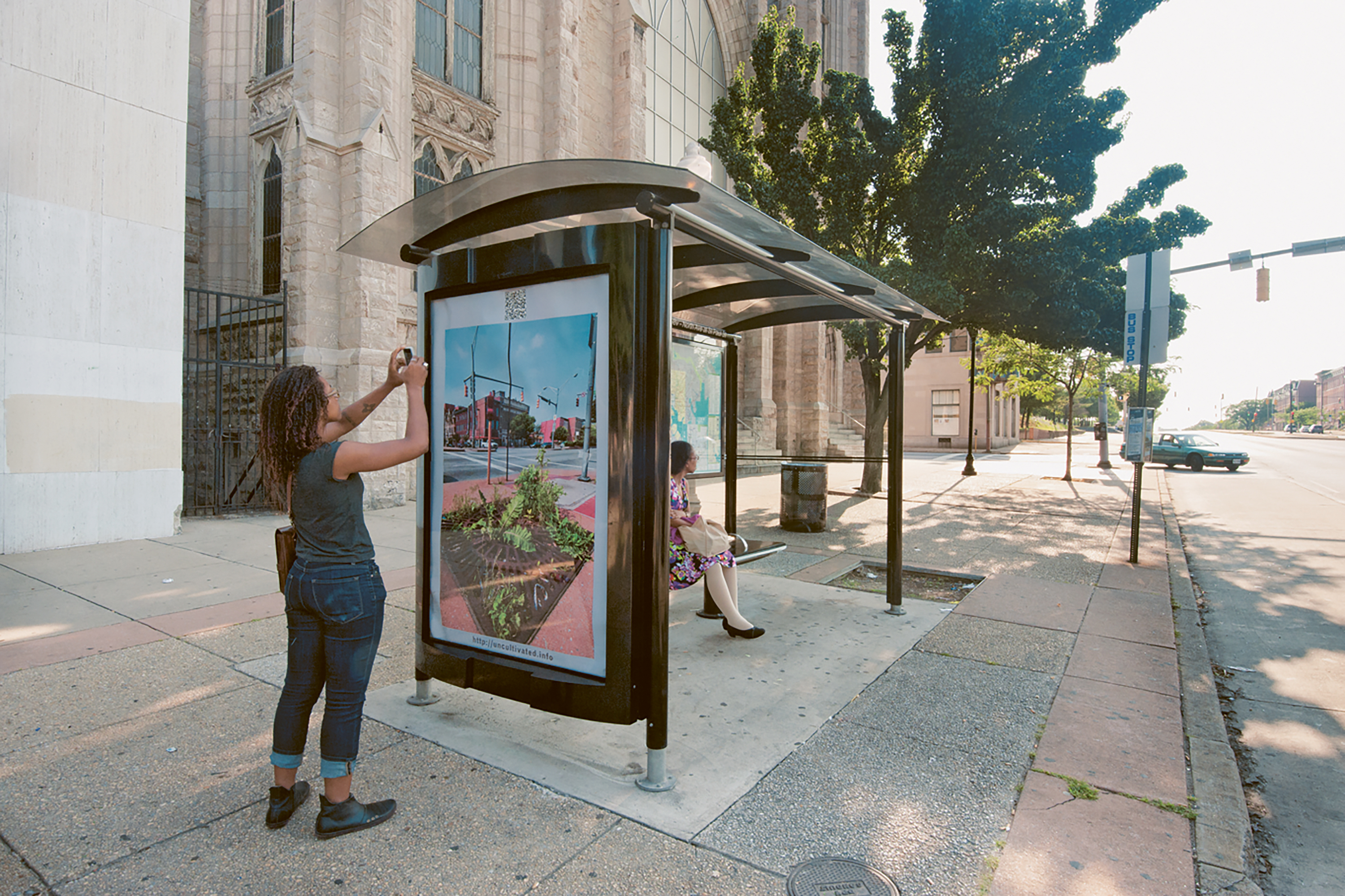 Demonstration of site specific poster for transit shelter, North Avenue, Baltimore, 2011. Art by Lynn Cazabon from the series Uncultivated.