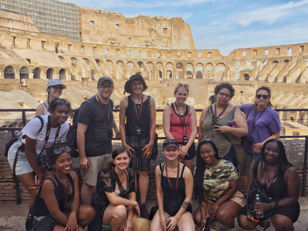 UMBC students stop for a group photo in front of the Colosseum in Italy.