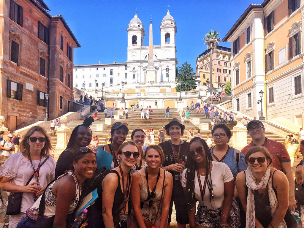 UMBC students pose in front of the Spanish Steps in Rome.
