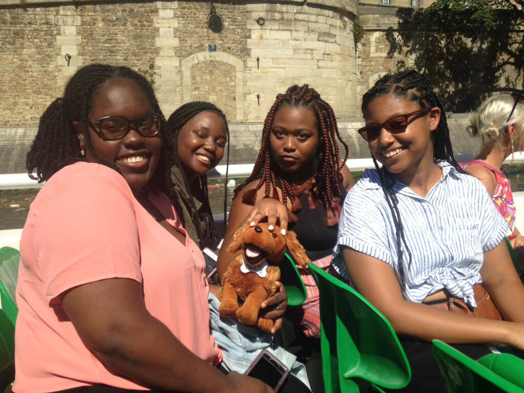 UMBC students bring stuffed mascot True Grit on a boat ride in France.