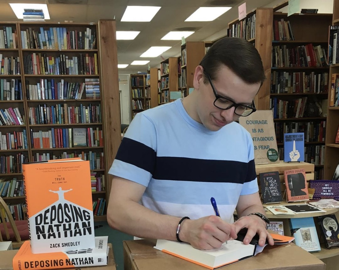 Zack Smedley '18 signs copies of his book. Photo courtesy of the author.