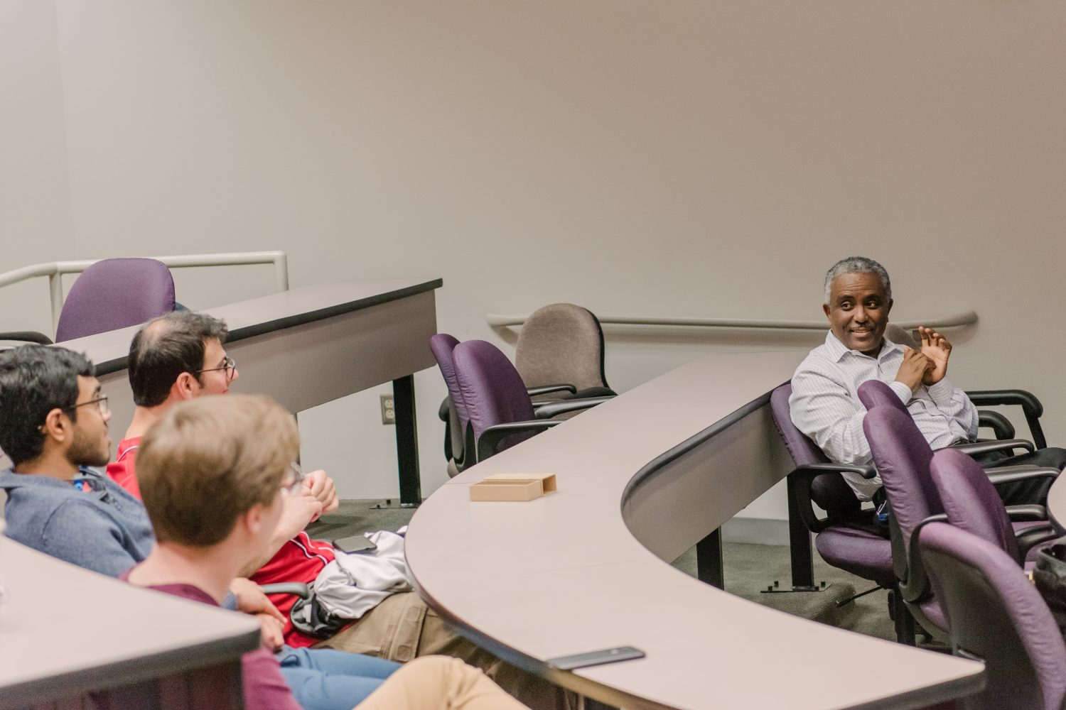 Demoz engages his students in robust discussions about their research. Photo by Marlayna Demond '11.