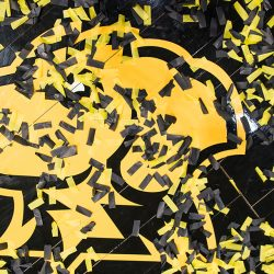 Black and yellow confetti rests on the UMBC basketball floor