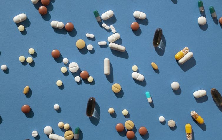 Assortment of pills on a blue background