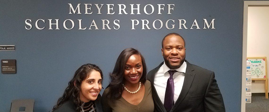 Kizzmekia Corbett, Akanksha Raja Lewis and Nnamdi Osia in front of Meyerhoff Scholars Program sign