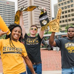 Students in UMBC spirit gear cheer in Baltimore