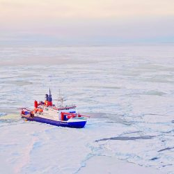 The ship RV Polarstern floats in the icy artic waters