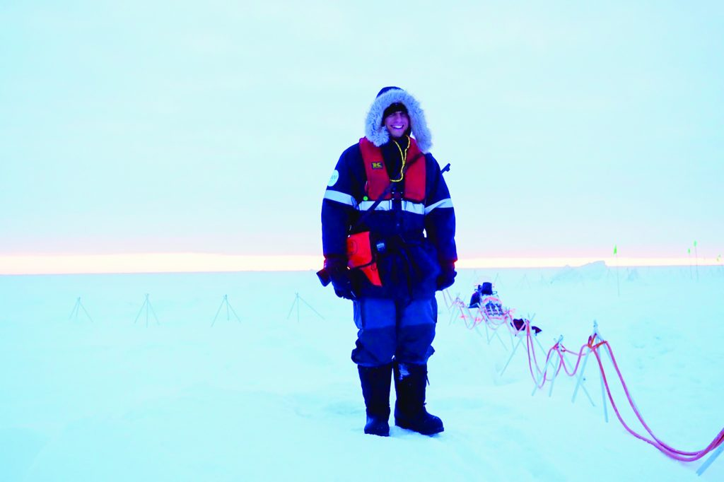 a man stands in the arctic