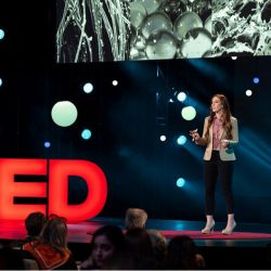 a women giving a TED talk