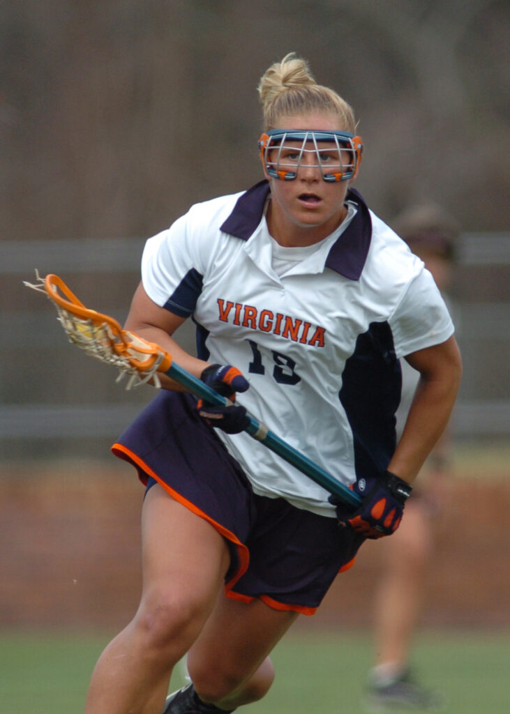 Amy Slade runs towards the camera in her University of Virginia lacrosse uniform during a game.