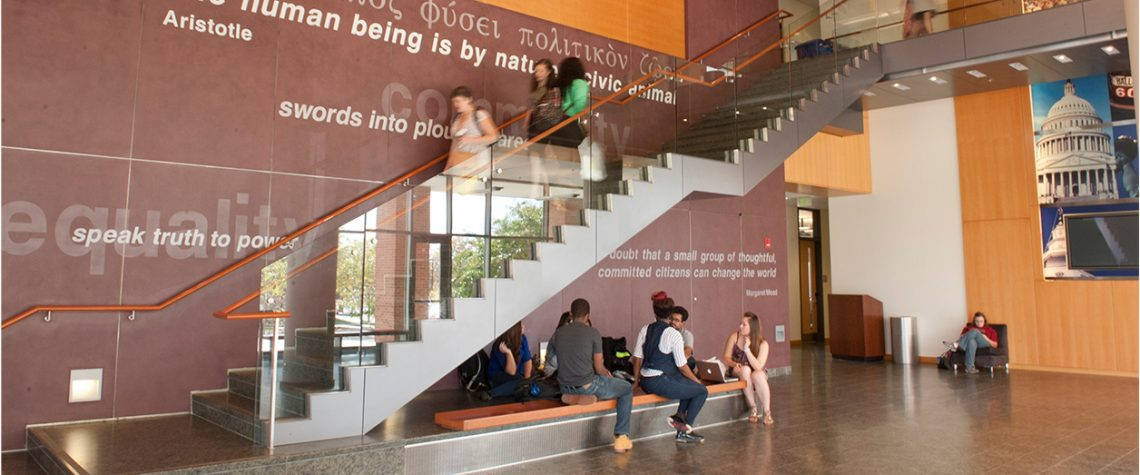 Students walk down the staircase inside the public policy building in 2017.